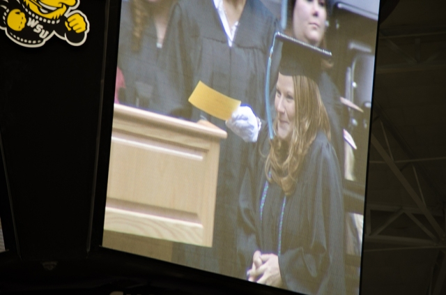 Nikki on the big screen ready to accept her degree.